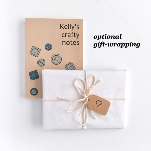 Notepad gift-wrapped in recycled tissue and string