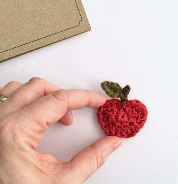 Crocheted red apple brooch