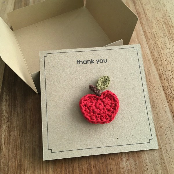 Recycled card and envelope with red apple brooch