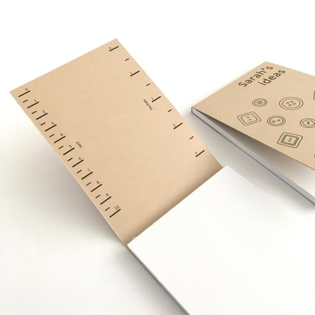 Inside cover of recycled notepad with printed rulers