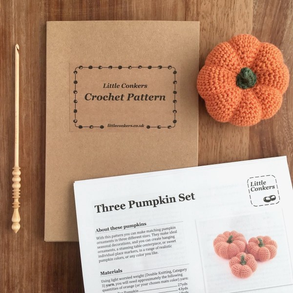 Printed crochet pattern for three pumpkins in a kraft folder