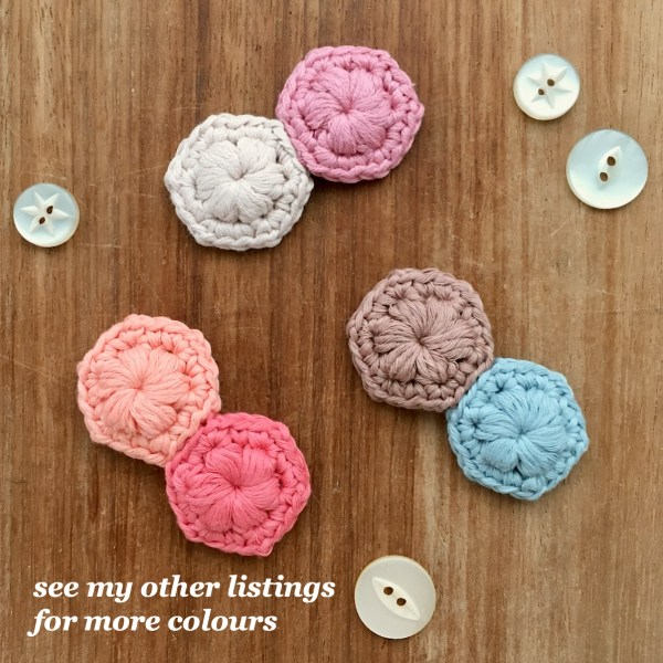 Crocheted hexagon brooches in different colours