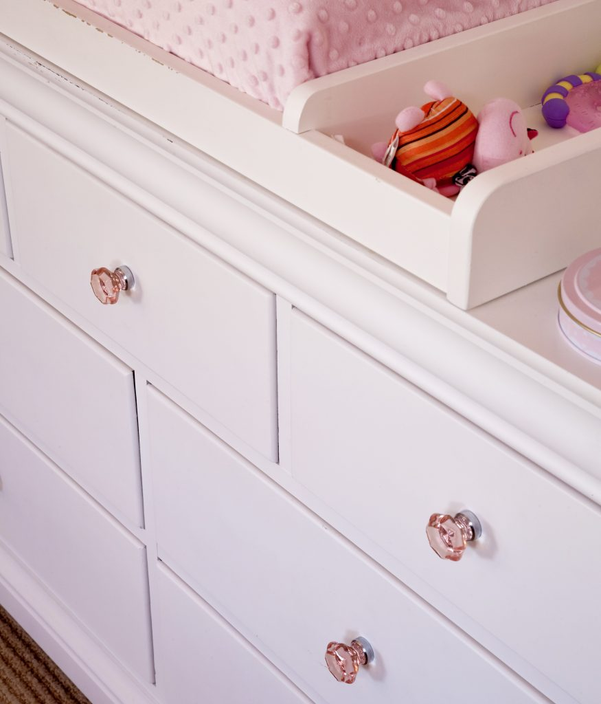Changing Table with Crystal Pink Knobs | Little Crown Interiors