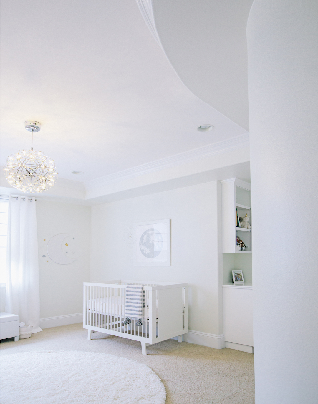 All White Celestial Nursery by Little Crown Interiors