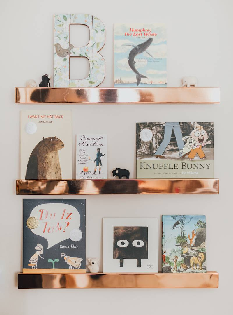 Pretty Books on Rose Gold Wall Ledges