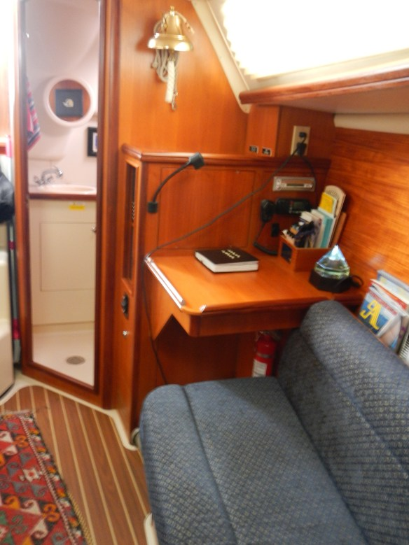 Looking aft at the chart table and entrance to the head.