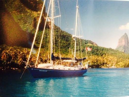 That's our boat in the South Pacific. Notice the Minto on the foredeck. Notice the double furling foresails. Notice how pretty she is.