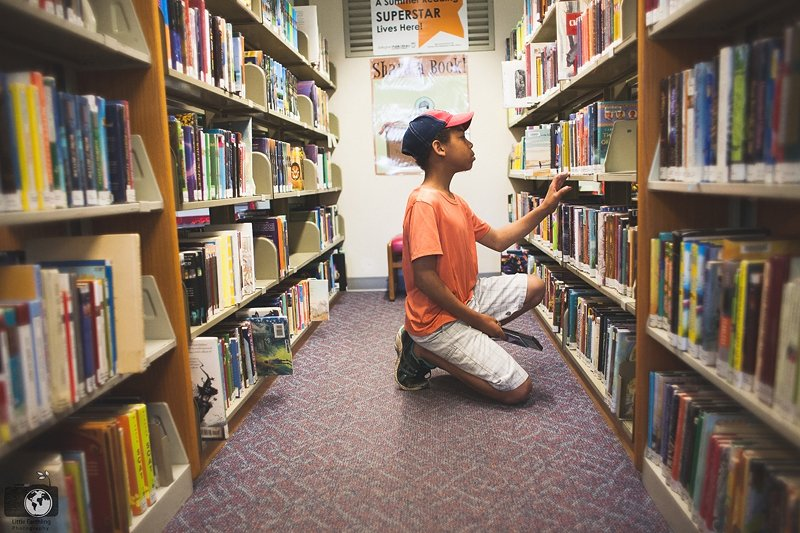 boy choosing library book