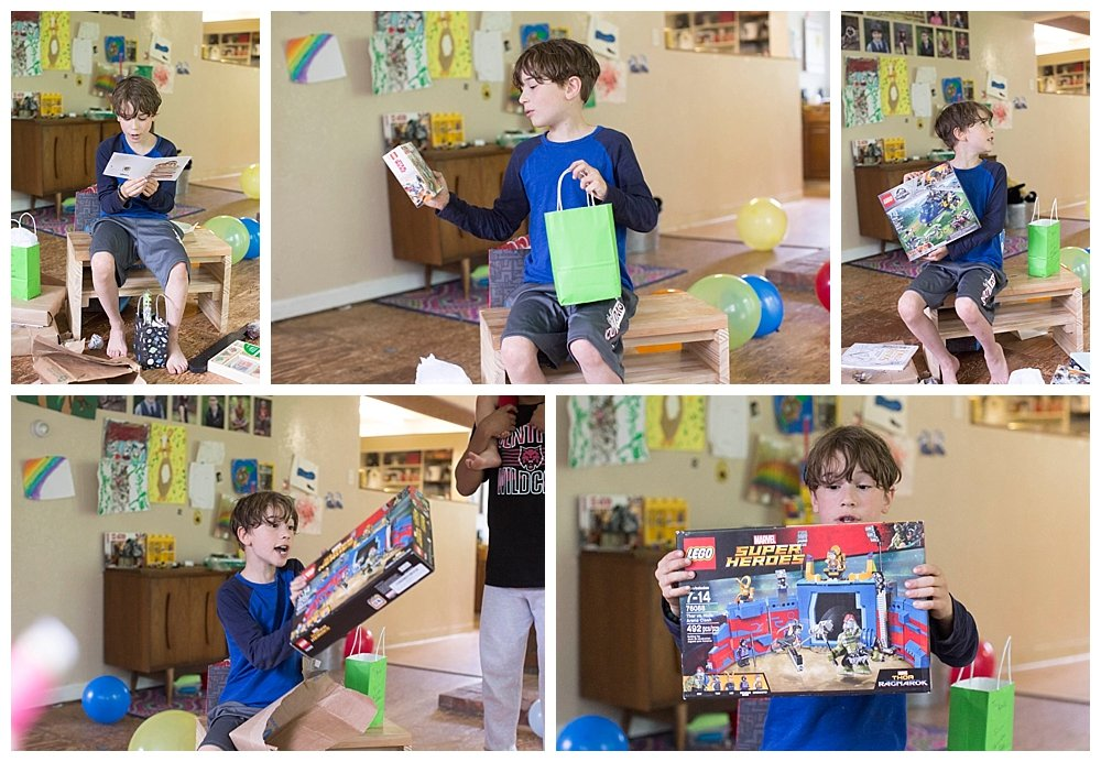 Apollo opening presents at his Hobbit Party.
