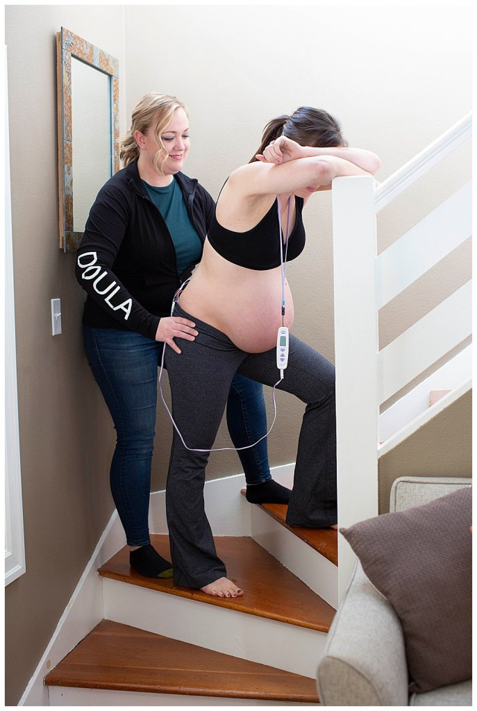 Christi Banks of Doulas of Bellingham helps her client who is using a TENS machine to manage labor.