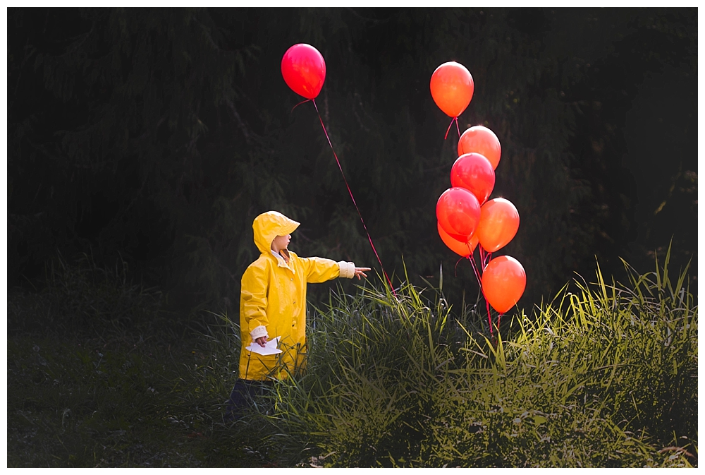 Little boy dressed as Georgie in Stephen King's It. We all float down here.