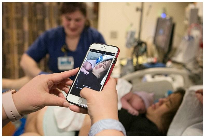 Grandma snaps her first photo of newborn baby girl, Umiko.