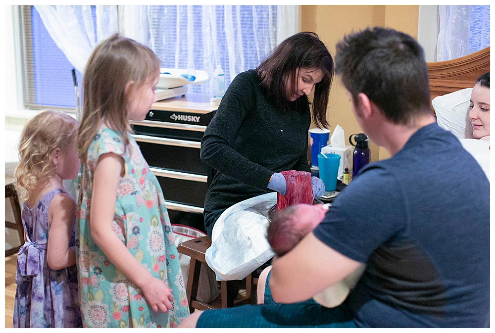 Midwife shows children a placenta at Bellingham Birth Center. Renee Bergeron Little Earthling Photography.