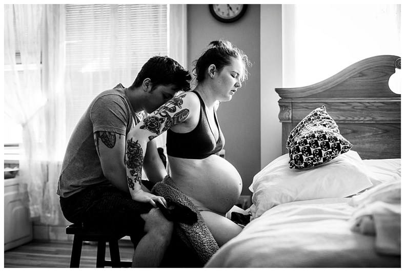 Husband comforting wife during labor at Bellingham Birth Center. Photography by Renee Bergeron.