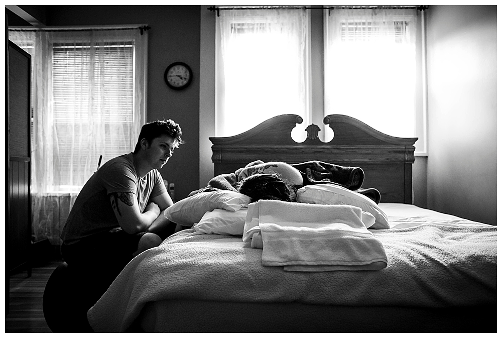 Woman laboring at birth center. Bellingham birth photography by Little Earthling Photography.