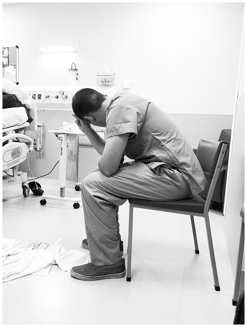 Nervous husband waits for his wifes c-section.