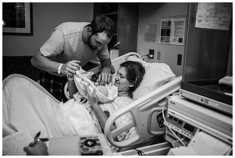 Mom and dad with baby just after birth. Bellingham birth photography.