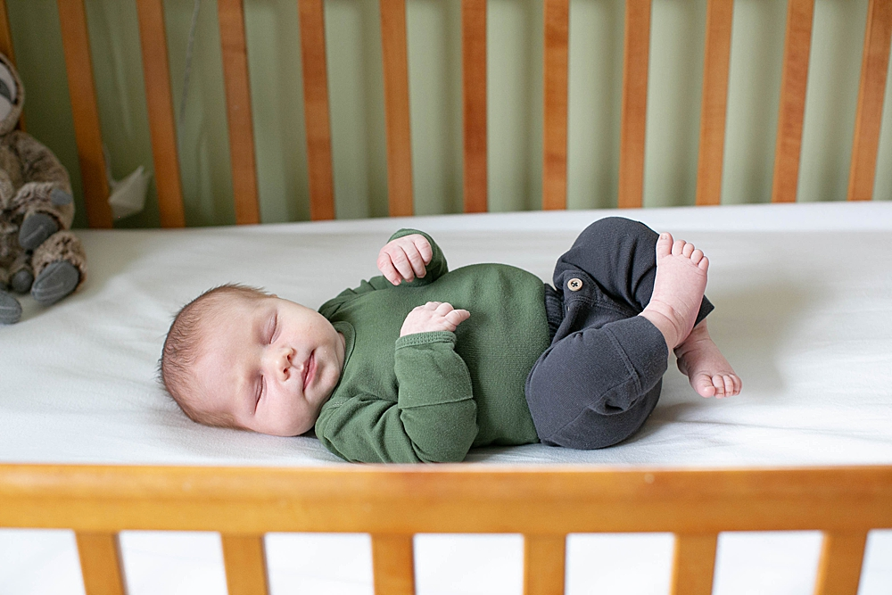 Newborn sleeping in crib. Bellingham newborn photographer.