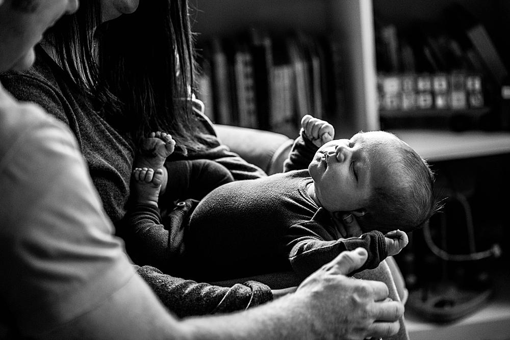 Black and white portrait mom and dad holding newborn. Bellingham newborn photography.