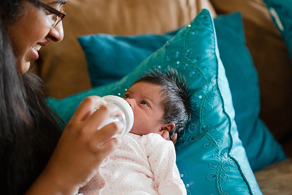 Mom bottle feeding newborn. Fed is best, Bellingham, WA