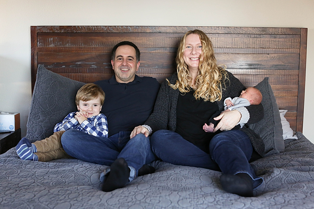Lifestyle portrait of family with newborn and toddler.