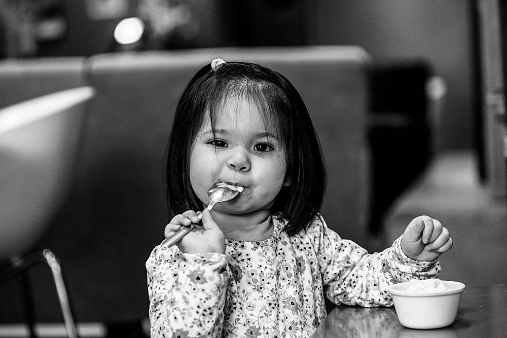 Erin enjoying ice cream at Mallard Ice Cream during her urban milestone session.