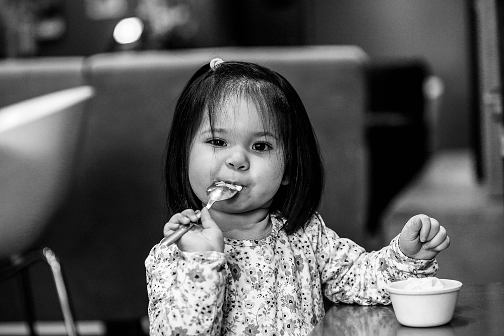 Erin enjoying ice cream at Mallard Ice Cream during her urban milestone session.
