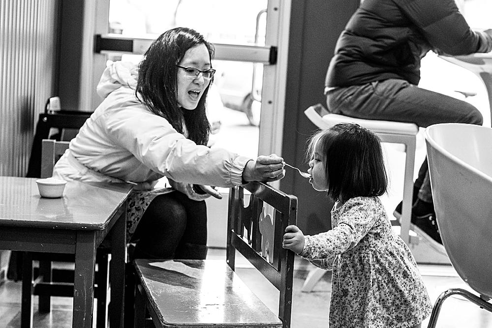 Busy toddler eating ice cream at Mallard Ice Cream.