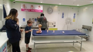 Playing in the baby care unit at Kidzania.