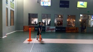 Playing cricket at Kidzania.