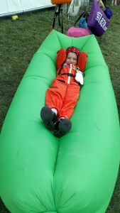 Noah relaxes on an inflatable air sofa.