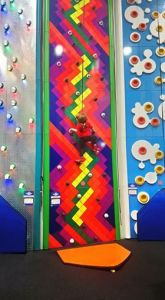 Noah climbs one of the many walls at Rock It! climbing centre in Hull.