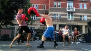 Grown ups take part in the Boxing show at Freedom Festival.
