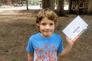 Noah shows his certificate for completing the course at Go Ape.
