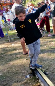 Noah challenges walks the tight rope at Circus Avago, Freedom Festival.