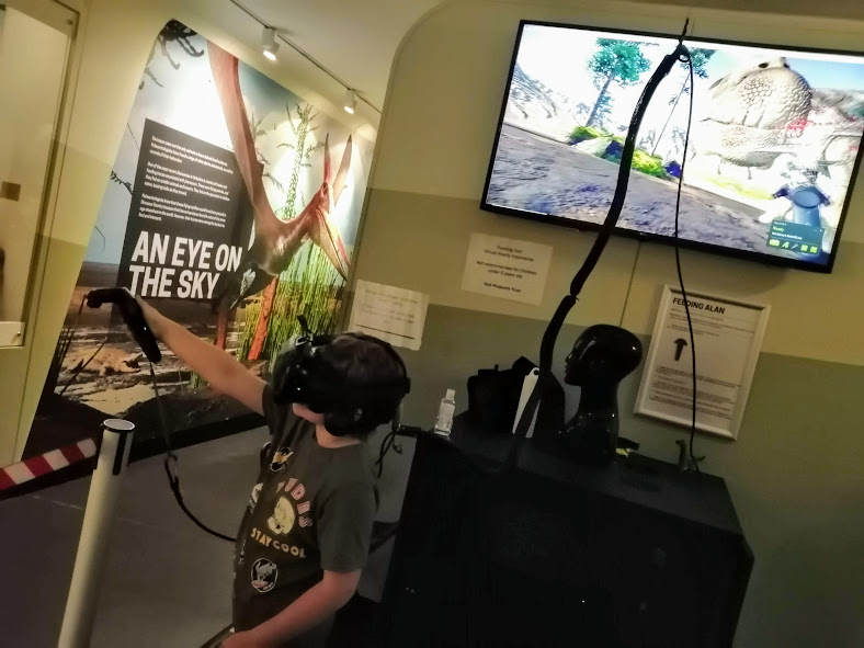 Noah tries a virtual reality headset at Yorkshire's Jurassic World