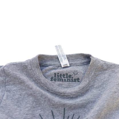 Little Feminist grey kid's shirt inside label