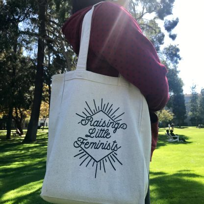 Raising Little Feminists book tote in action