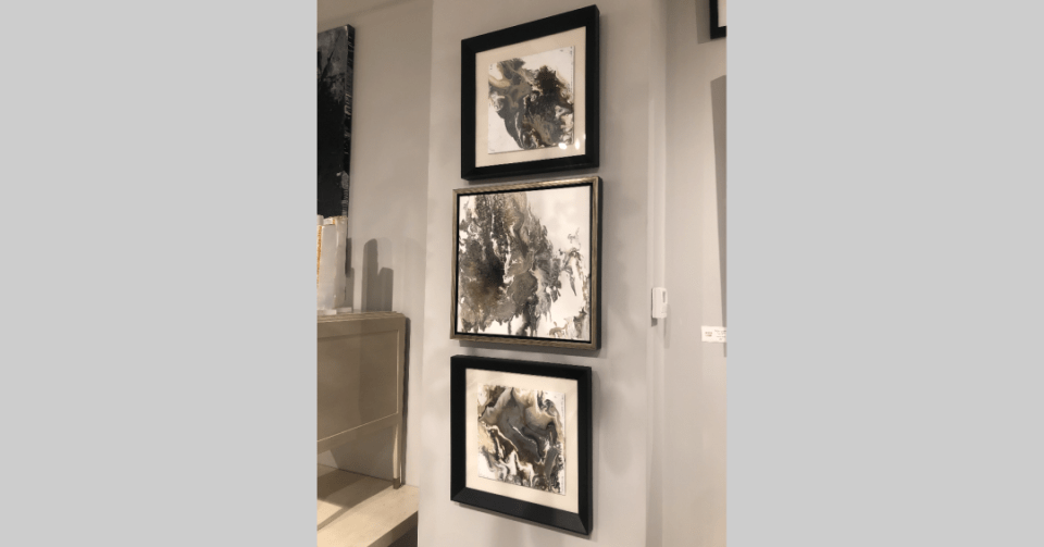 floating frame marble abstract displayed in showroom with two other marble paintings by Stephanie Wheeler