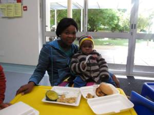 photo of Mother and child receiving lunch with love