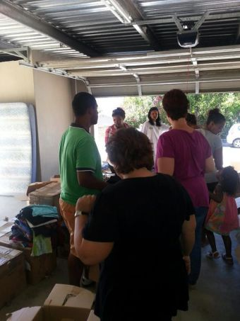 Volunteers sorting and packing - T&T's garage
