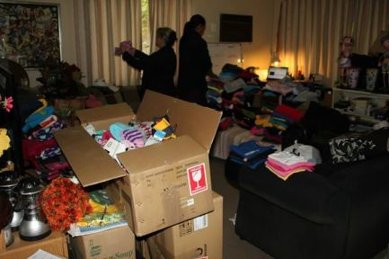 Sorting Clothing Donations for Get WRAPPED Project