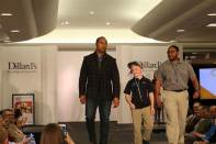 Braylon Beam walking with NFL coaches, which is the profession he hopes to be in some day