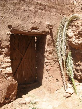 A small door for goats in the courtyard. Ait Ben Haddou.