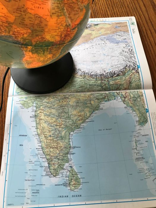 Photo of a Globe and Open Atlas