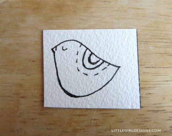 Step two in how to make a little bird bookmark @littlegirldesigns.com