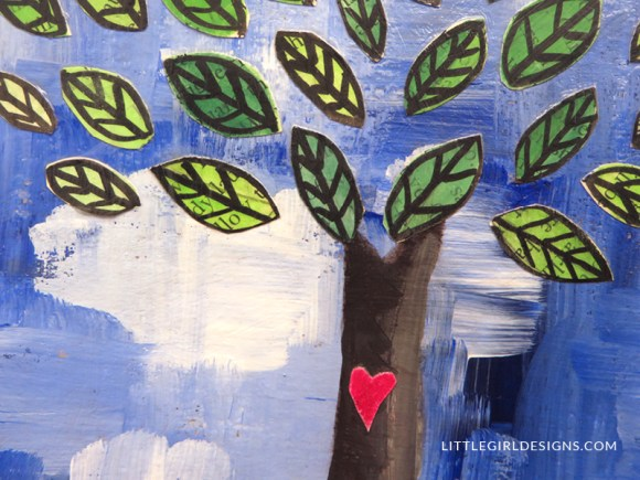 Make An Art Journal: Tree Collage Cover - How to make an art journal cover using chip board, paint, and collage. This is the second post in a series on how to make your own journal. You could also use this technique to make a painting of a tree collage for your home. Makes a great gift! @ littlegirldesigns.com