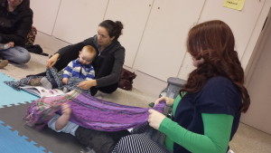 mom and baby class playing with scarves to promote brain development