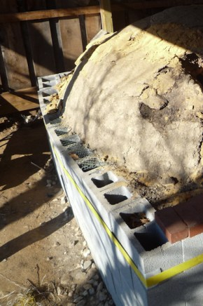 Unmortared foundation wall bowing outward