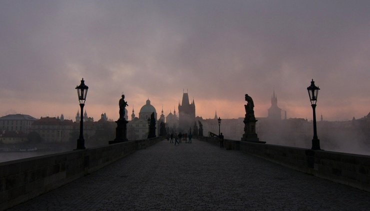 The eerie beauty of Prague's Charles Bridge at dawn.